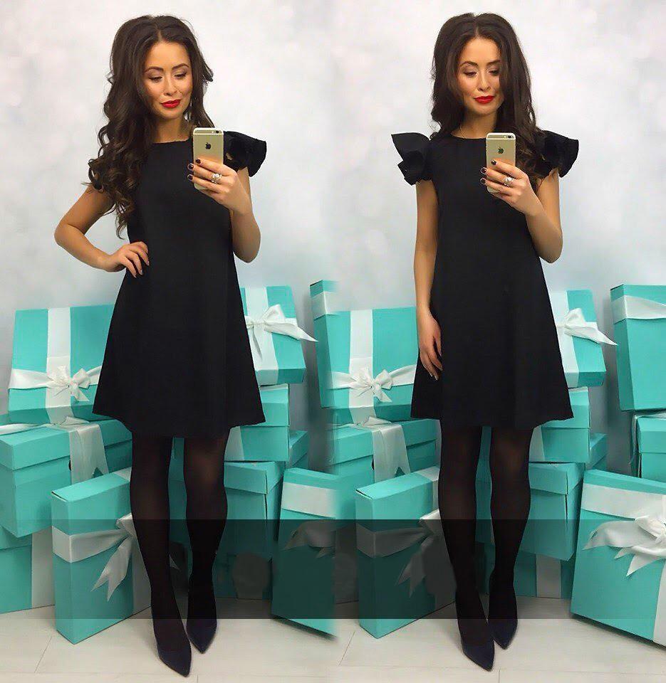 Dámské šaty s volánky a bez rukávu černé